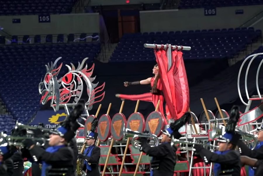A+color+guard+member+stands+atop+a+prop+during+one+of+their+final+shows+of+the+season.+The+winter+guard+will+perform+in+their+second+major+competition+at+the+Indy+Regional+this+weekend%2C+Feb.+16-17.+Krissy+Sass%2C+guard+member+and+sophomore%2C+said+she+has+high+hopes+for+the+competition.
