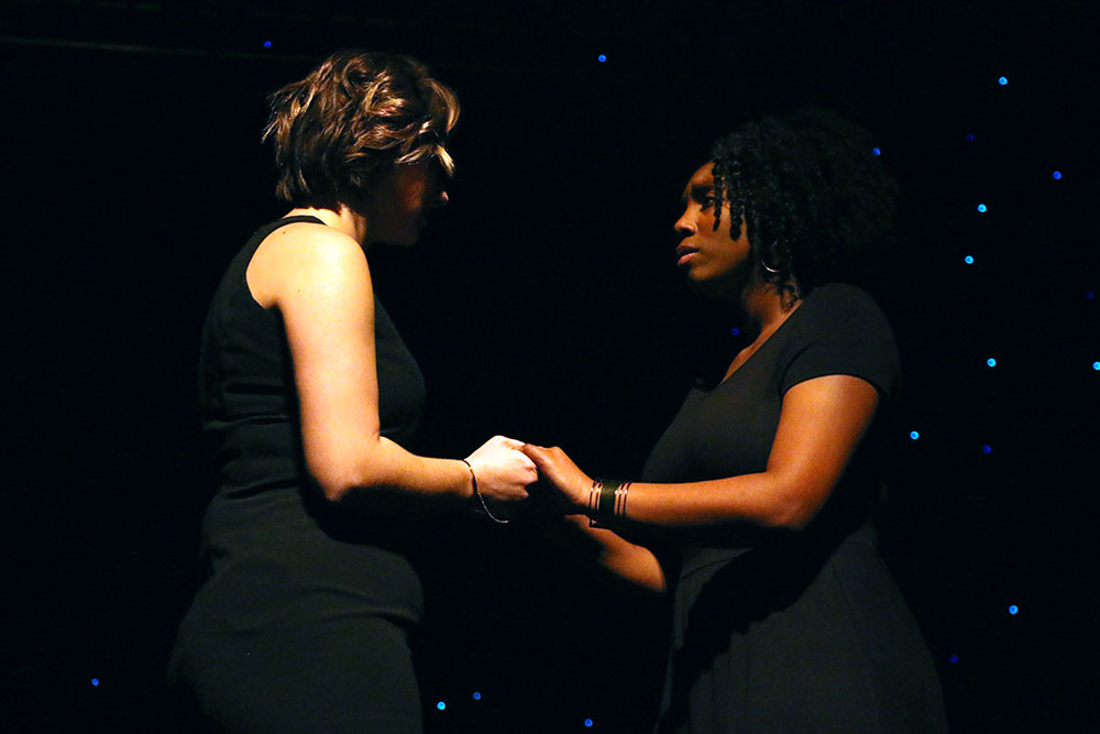 Two actresses from the KJI Institute for the Arts perform a monologue at the inaugural Martin Luther King Jr. Celebration event. They took on the roles of Violet Gregg Liuzzo (on the left) and Sarah Evans (on the right), two activists of the National Association for the Advancement of Colored People (NAACP).