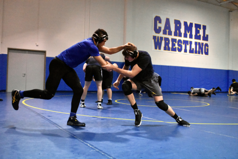 Wrestlers and seniors Jack Heldt and Cameron Bacon train with each other during wrestling practice after school in February. Heldt said as a senior, he had certain expectations for the season, and for the most part, he said he met them.