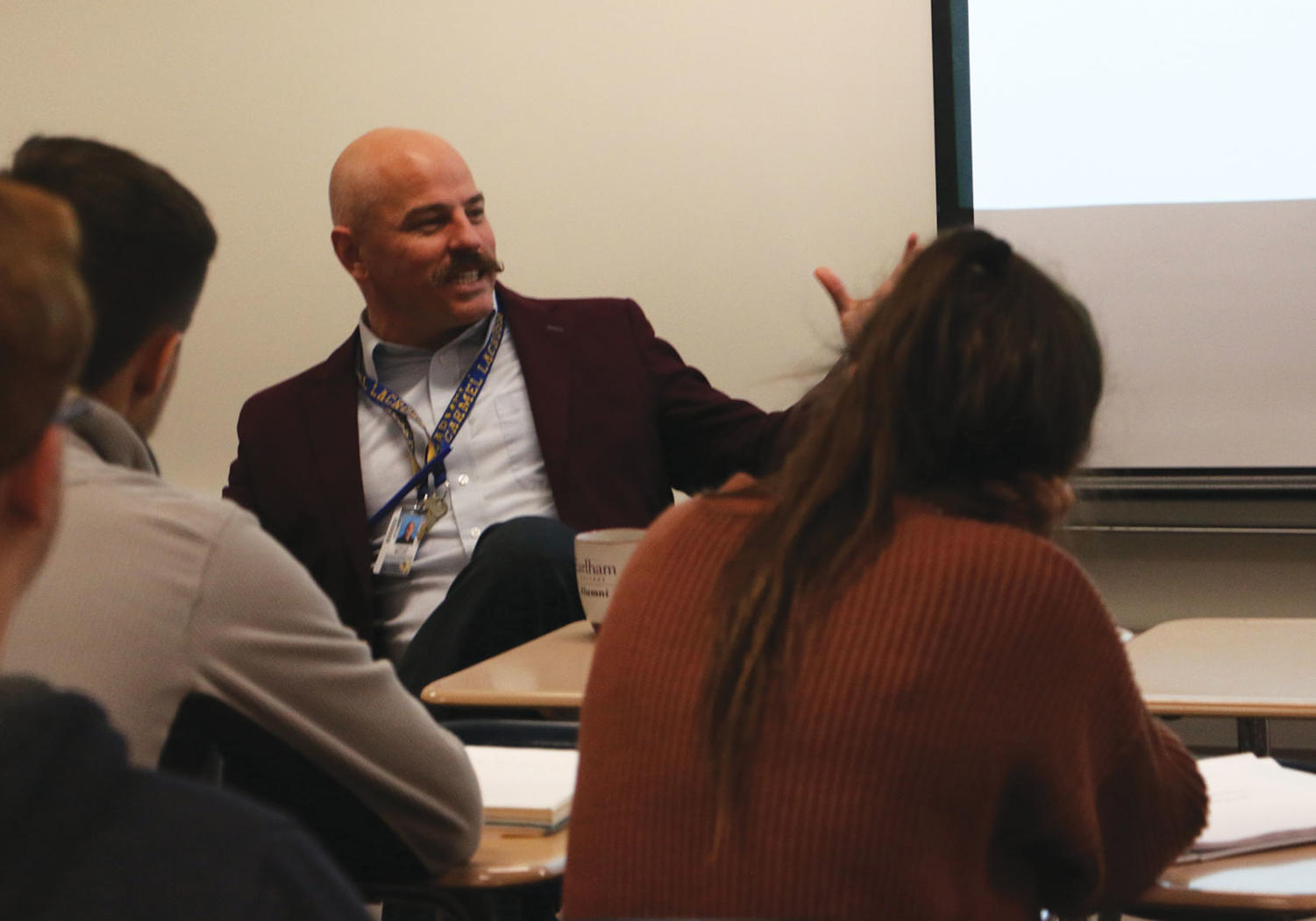 Special Speakers: Social studies teacher Joshua Miller lectures in his class on Feb. 13. The class was learning about the role of media, which Miller said plays a part in civic literacy today.