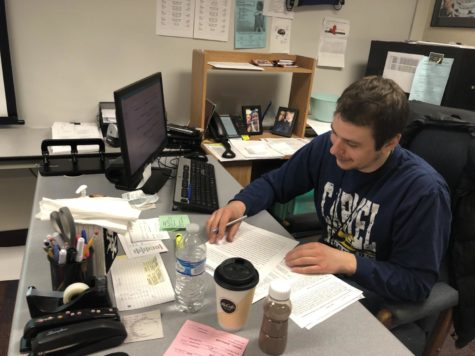 James Ziegler, Academic Super Bowl co-sponsor and social studies teacher,  creates an agenda for the Academic Super Bowl team for its upcoming  meet at Ben Davis. According to Ziegler, the competition can take up to five hours.