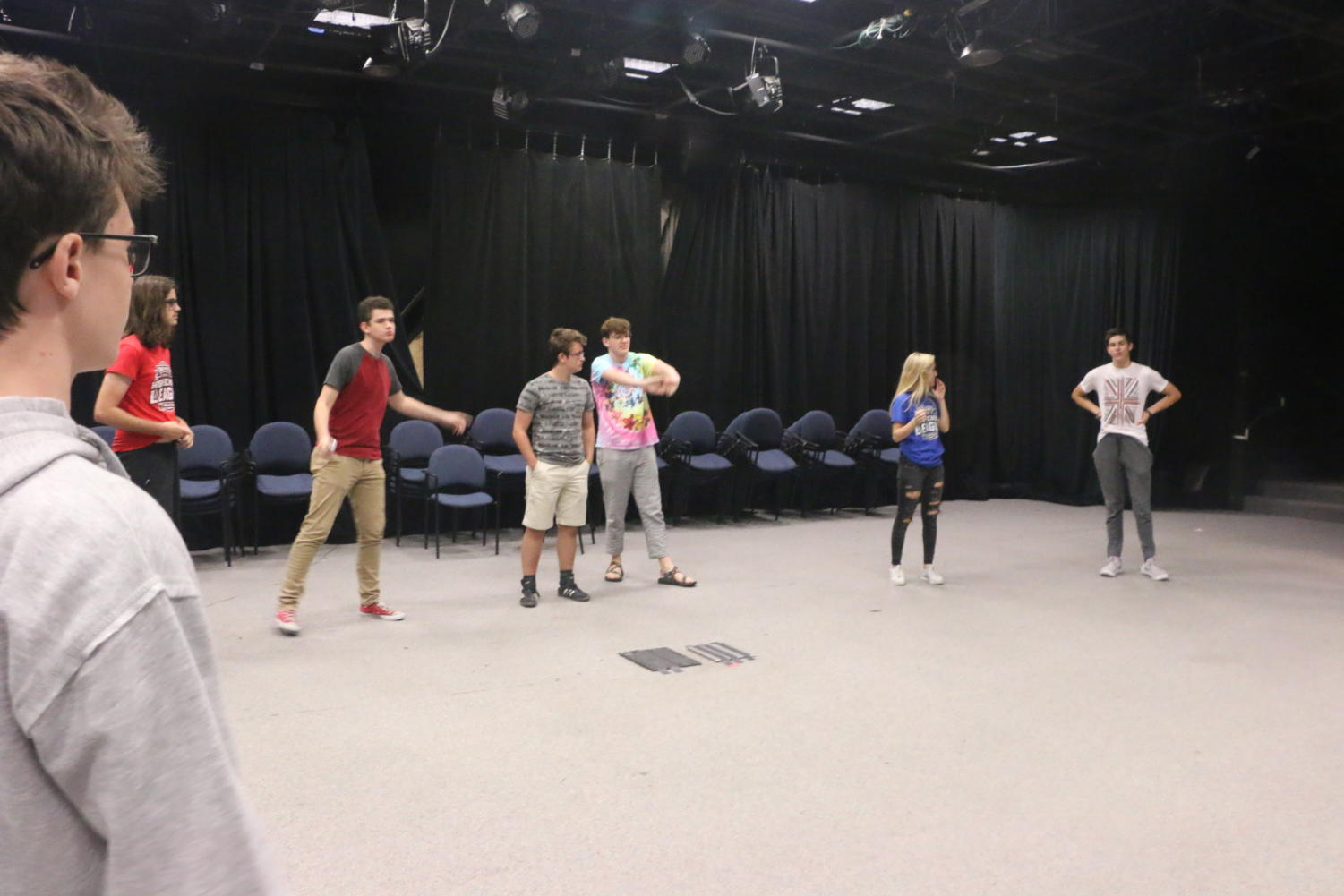 ComedySportz members warm up playing a game called