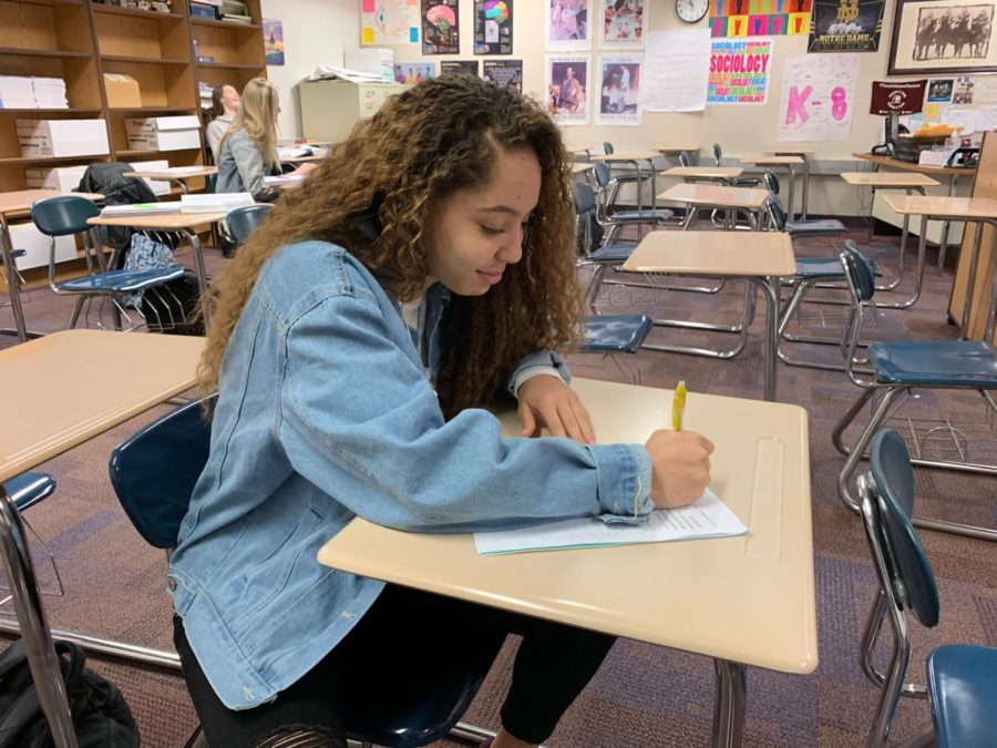 Kiara Gill, K-8 mentor and junior, studies during SRT. She said she joined the class to meet more kids and help her community.