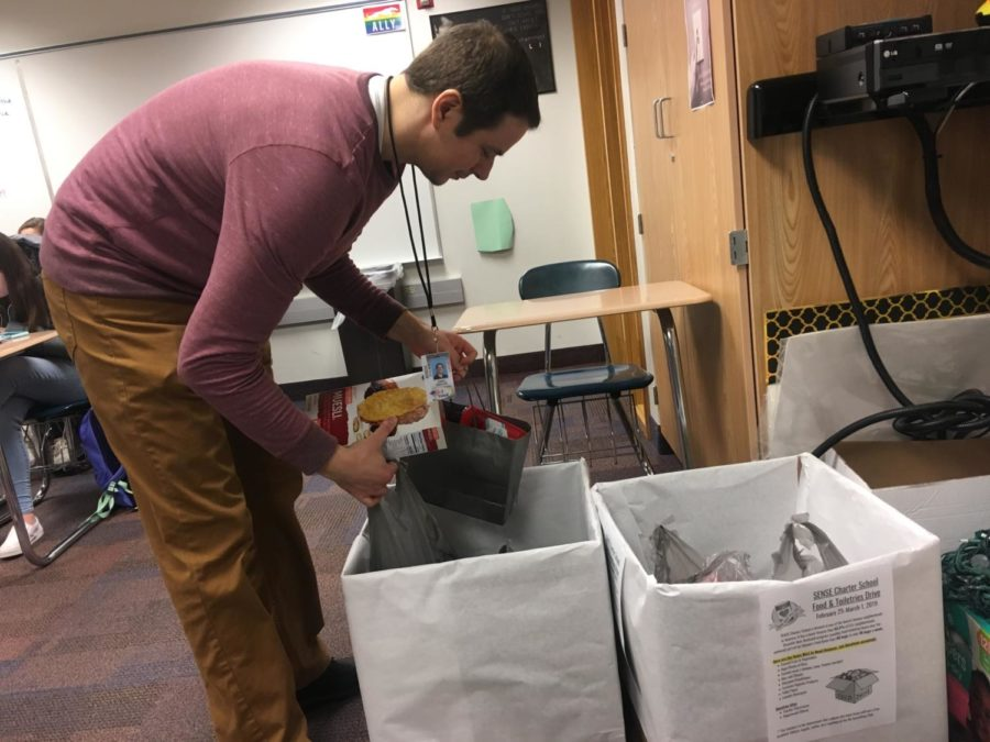 Do Something Club sponsor James Ziegler organizes donations for the SENSE Charter School canned food drive that the club is currently conducting. Ziegler said that the fundraisers, which is a competition between the various departments of the school, will March 5.