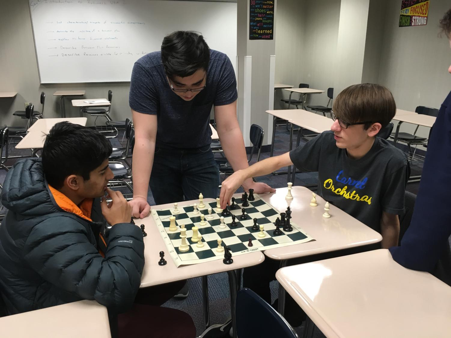 Julian Knudson, president of the club and senior, oversees a game between Rohil Senapati and Owen Eckart. Knudson said he has finalized the A, B, and C teams for the tournament, which he compiles based on skill demonstrated by students throughout the year.