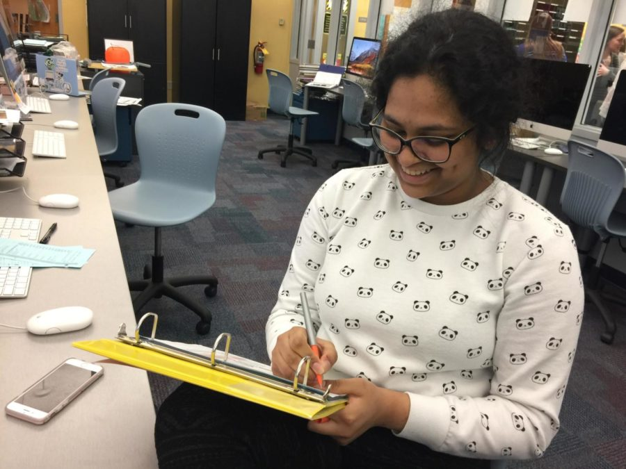 Sandiya Sajan, Pinnacle yearbook section editor and junior, check the many deadlines that she and her co-editors need to assign for the reporters and photographers under their section. Sandiya Sajan co-edits with other staff members under the student life and academics section.