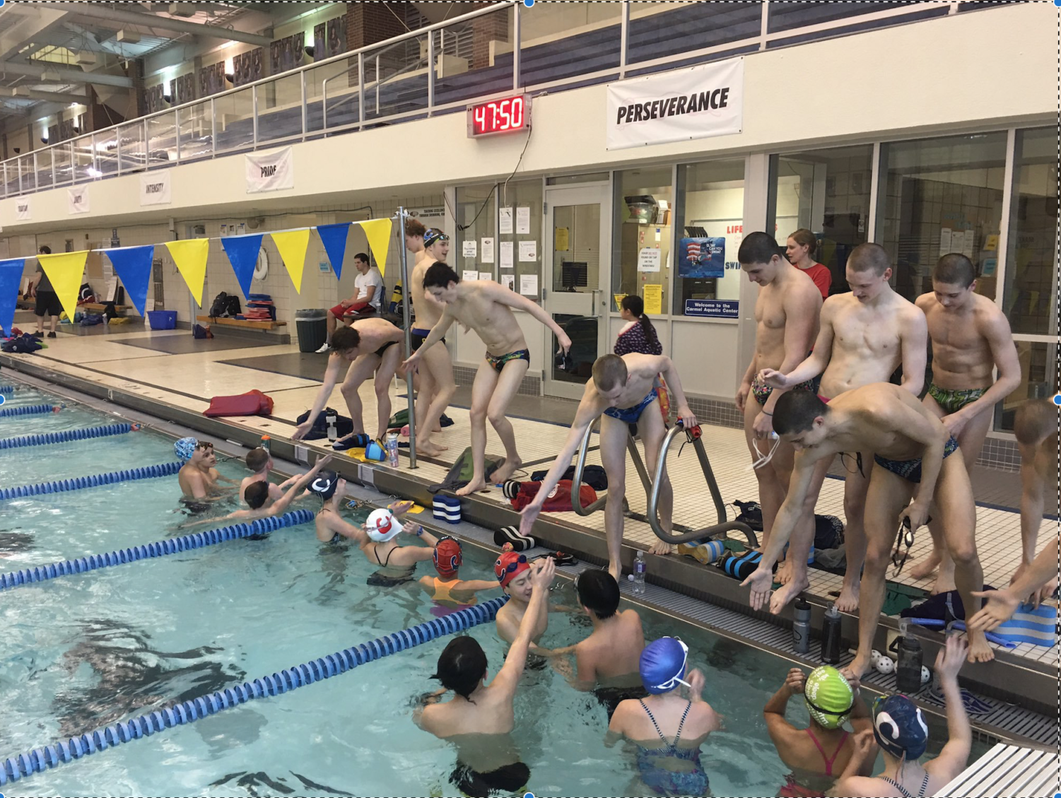 "Both swimming teams finish a time trial during the evening practice. ""We usually have boys' and girls' practice together,"" Plumb said."