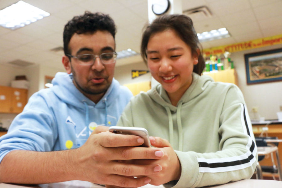 MEME TIME: Sophomores Annie Kim and Lalith Roopesh react to a funny post on Instagram after school. Kim said she enjoys looking at memes and other funny content on social media and sharing them with her friends.