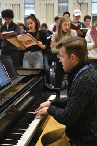 KEYS TO SUCCESS (RIGHT): Kyle Barker, associate director of choirs, plays the piano during a rehearsal. Barker said he hopes that this musical will target a different audience.