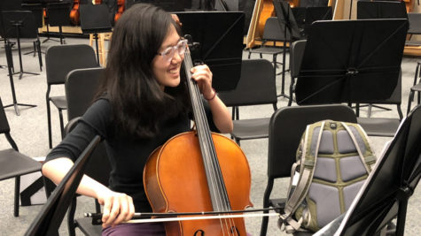 "Selin Oh, Camerata cellist and senior, practices her cello in the orchestra room after school. Oh said she especially looks forward to playing Vivaldi's ""Four Seasons,"" which was composed to go along with four sonnets."