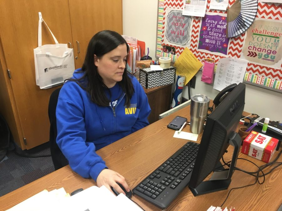 """AVID teacher Elizabeth Galvan works at her desk and prepares for her class. """"(AVID) gets students comfortable with being uncomfortable. The activities we do in class may not feel comfortable, but they get used to advocating for themselves and (they also) learn about the skills they need outside of high school."""""""