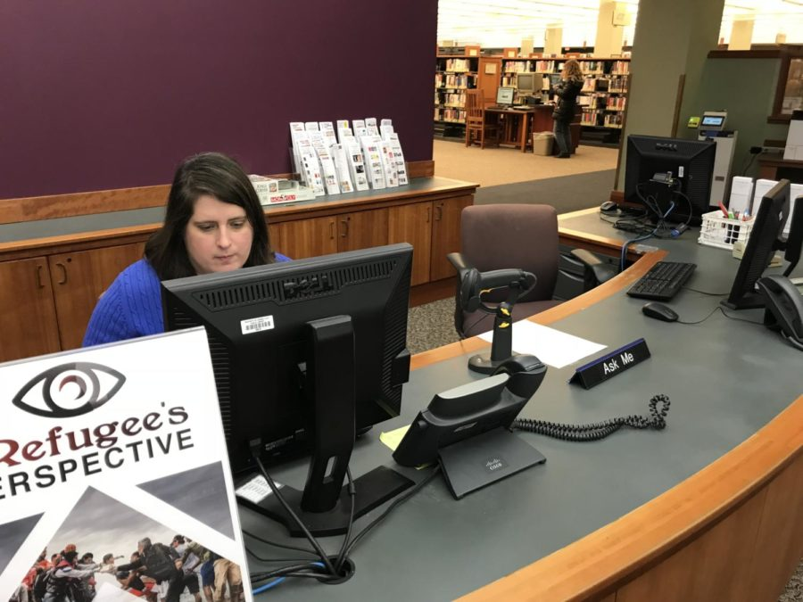 Young adult librarian Jamie Beckman works at the main desk of the young adult section of the Carmel Clay Public Library. Beckman and other librarians help coordinate programs such as Teen Novel Writing Challenge.