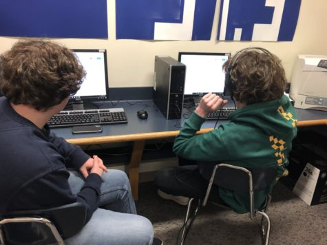In the computer lab, freshmen Tanner Rindfuss and Aidan West prepare their scripts for their first broadcasting session.