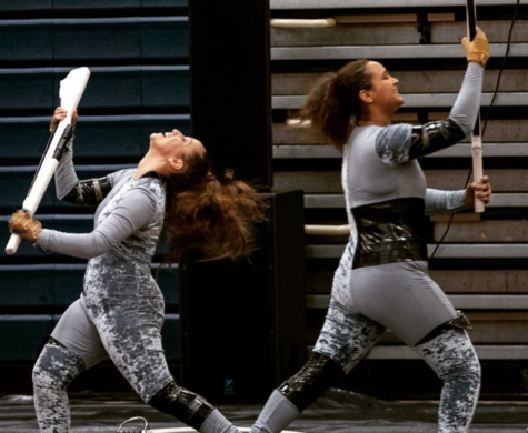 Two guard members successfully catch their rifles during a practice in the gym on March 13. As the winter guard season draws to a close, guard director Rosie Queen said the guard is shaping up to finish strong in the final stretch of competitions.