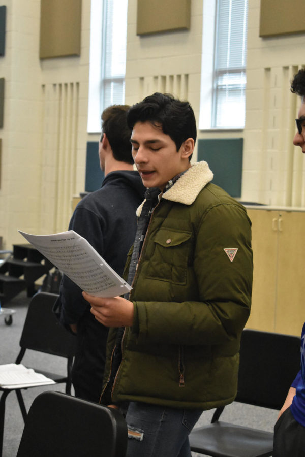 SINGING ALONG:  Joey Gutierrez, New Edition member and senior, sings during a New Edition class rehearsal. Gutierrez said he will not pursue a musical degree or profession during college, but choir has taught him many valuable skills.