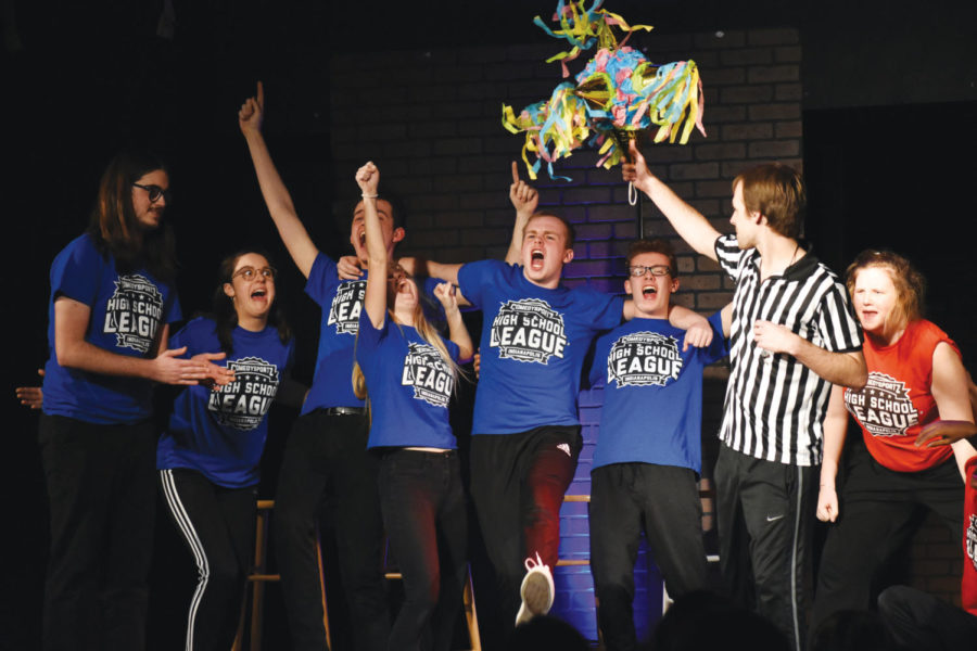 SWEET  VICTORY: Junior Kyle Fleckenstein and his ComedySportz teammates celebrate on stage after winning their ComedySportz match. Fleckenstein said he has participated in ComedySportz throughout  high school.