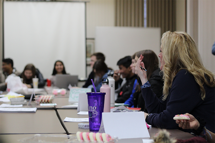 Kelli Prader, Carmel Mayor's Youth Council sponsor, addresses the council members during a meeting. Prader said she feels confident in the members' abilities and leadership.