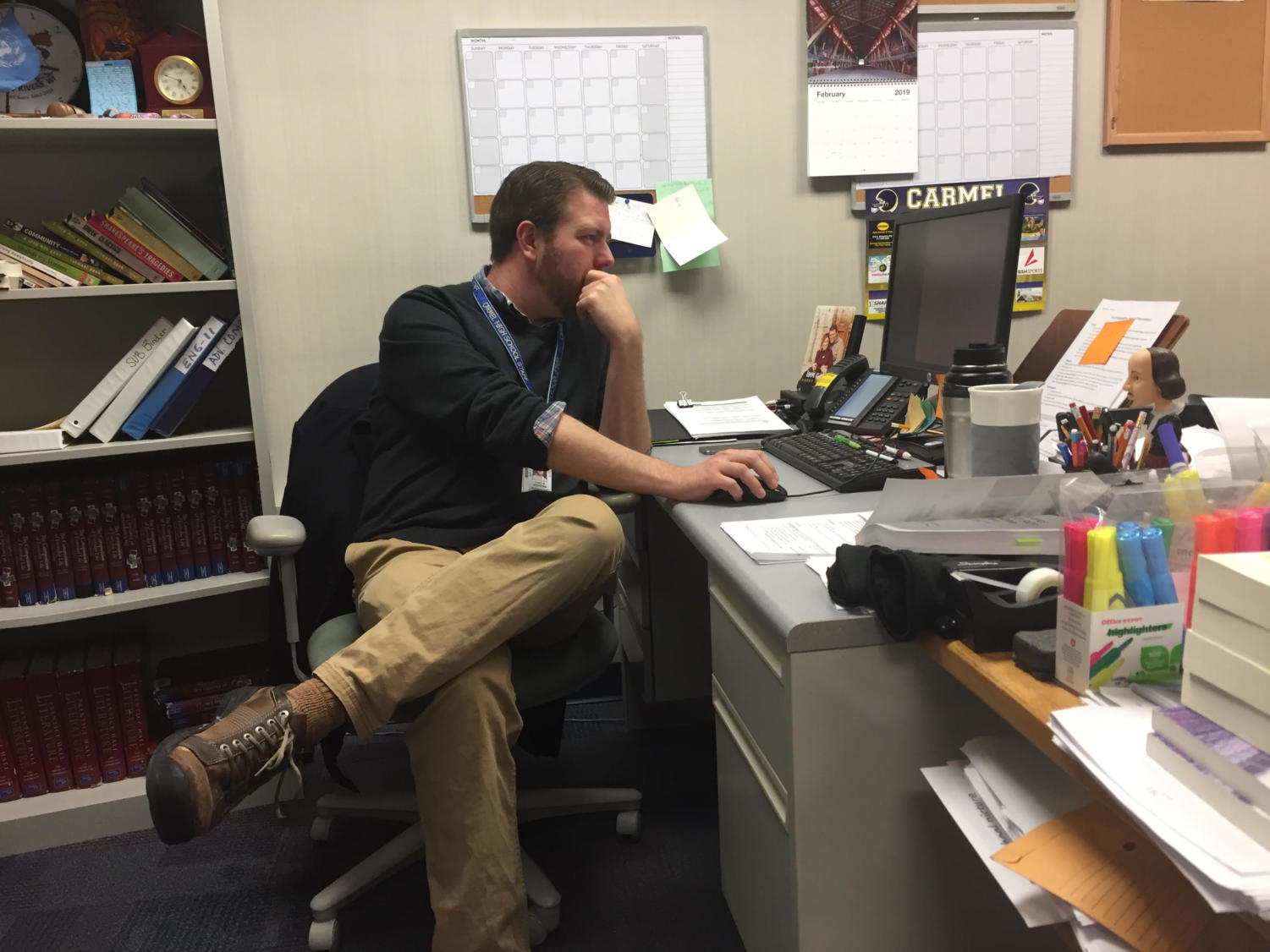 Chad Andrews, Teens with a Choice sponsor, works at his desk after school. He said the club has slowed down this semester.