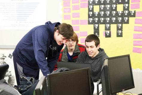Austin Prader, eSports Club president and junior, watches and helps his club members with a video game. Prader said he has gained leadership skills from playing video games and being a part of eSports Club.