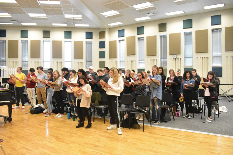 """Cast members of """"Bring it On"""" sing during a rehearsal. According to Kyle Barker and Sam Chenoweth, associate directors of choirs, the play will have an adapted cast list to accommodate CHS's population."""