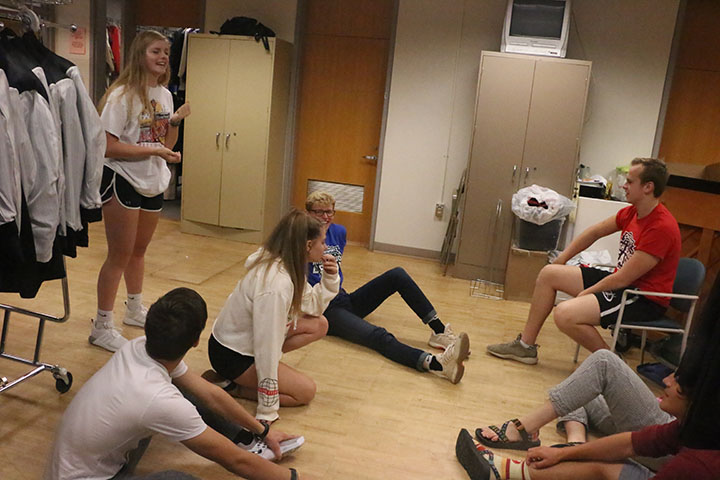 ComedySportz members laugh during rehearsal. The team had just finished a round of a comedic improv game.