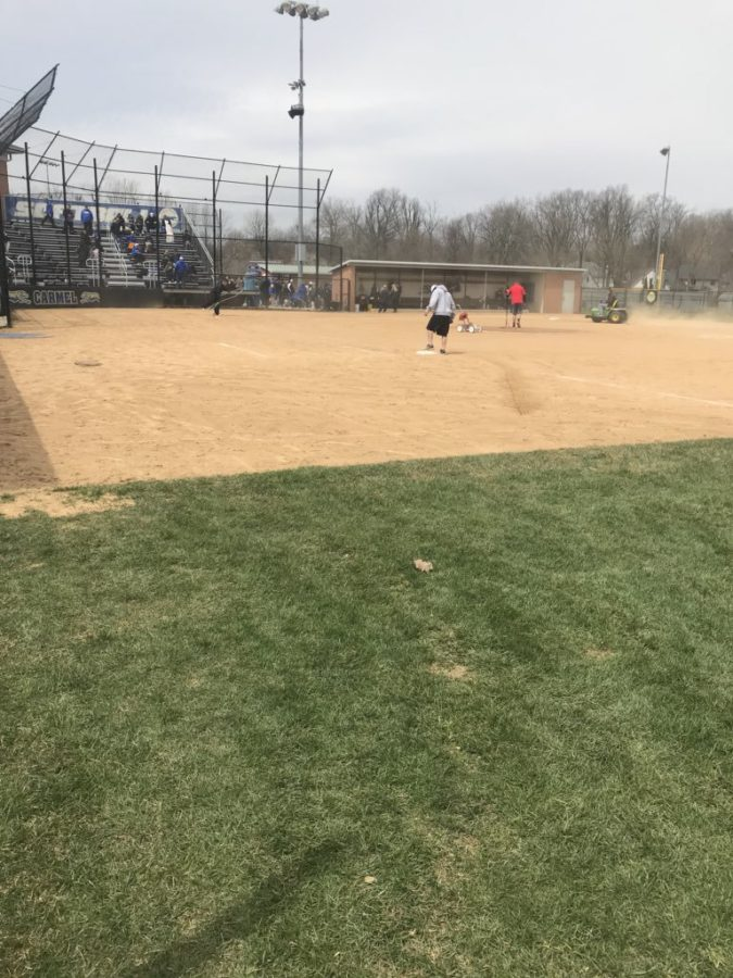 "The softball maintenance crew gets the field ready before the game versus Center Grove. ""We are hoping to win the Carmel Invitational,"" Zdobylak said."