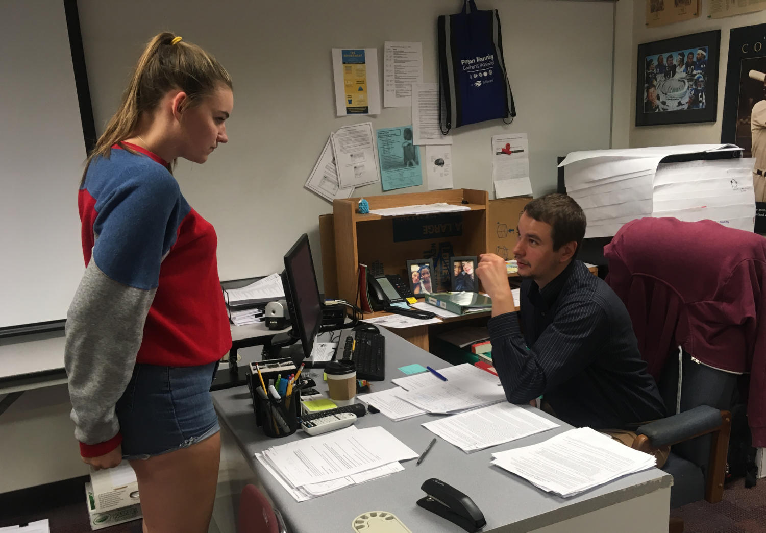 Do Something Club sponsor James Ziegler and Samantha Kadinger, Do Something Club member and senior, discuss the club's upcoming projects. Ziegler said that the main focus of the club in the upcoming weeks is to plan for the club's Veterans Walkathon on May 11.