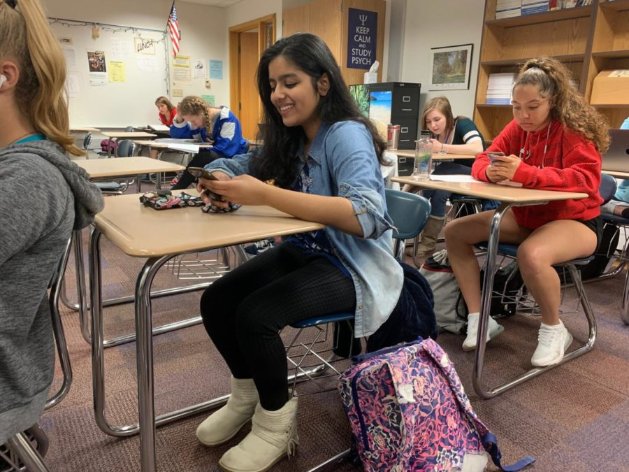 Mentor and senior Fareeha Mouzan goes through her phone during SRT. She said she's really enjoyed building closer relationships with her mentees and becoming more comfortable with them.