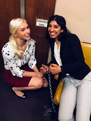 "Lina Waseem, Mock Trial member and junior, poses with teammate and junior Becca Counen in a courtroom during Regional. ""I have loved working with everyone on the team as well as the club sponsor, Mr. Browning. I can't wait to come back next year,"" Waseem said. Photo submitted by Lina Waseem"