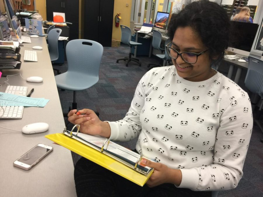 Sandiya Sajan, Pinnacle yearbook section editor and junior, checks off the various assignments that her section has done that may be added to the their portfolios. The portfolios consist of photos, writing, graphic designs and other media-related accomplishments.