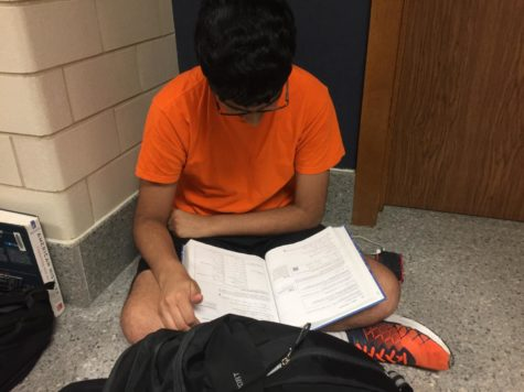 Abinay Devarakonda, Key Club secretary and junior, studies during outside of his math class. Devarakonda said he is happy that Key Club offers students the ability to give back to the community through volunteer work.