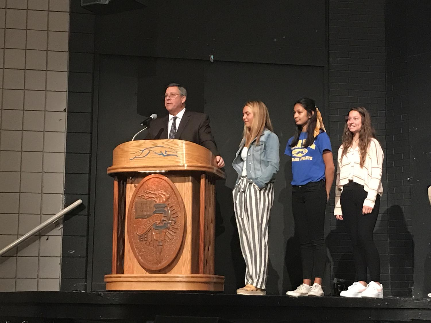 At a student recognition convocation on May 15, Principal Tom Harmas presents to students in the auditorium as well as through a CHTV broadcast, alongside senior class president Meredith Lipps, junior class president Ana Mercado and sophomore class president Mia Bruder. Harmas said he is currently working on hiring teachers for next year and drafting a potential new schedule with a later start for high school students.