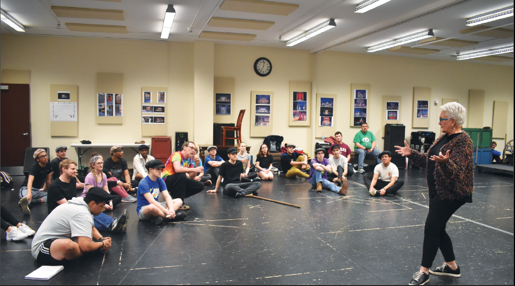 "FIGHT CLUB: Michael Geary (right), a freshman playing Elmer in ""Newsies,"" practices fight choreography. He said this is his first time in a show with adults."