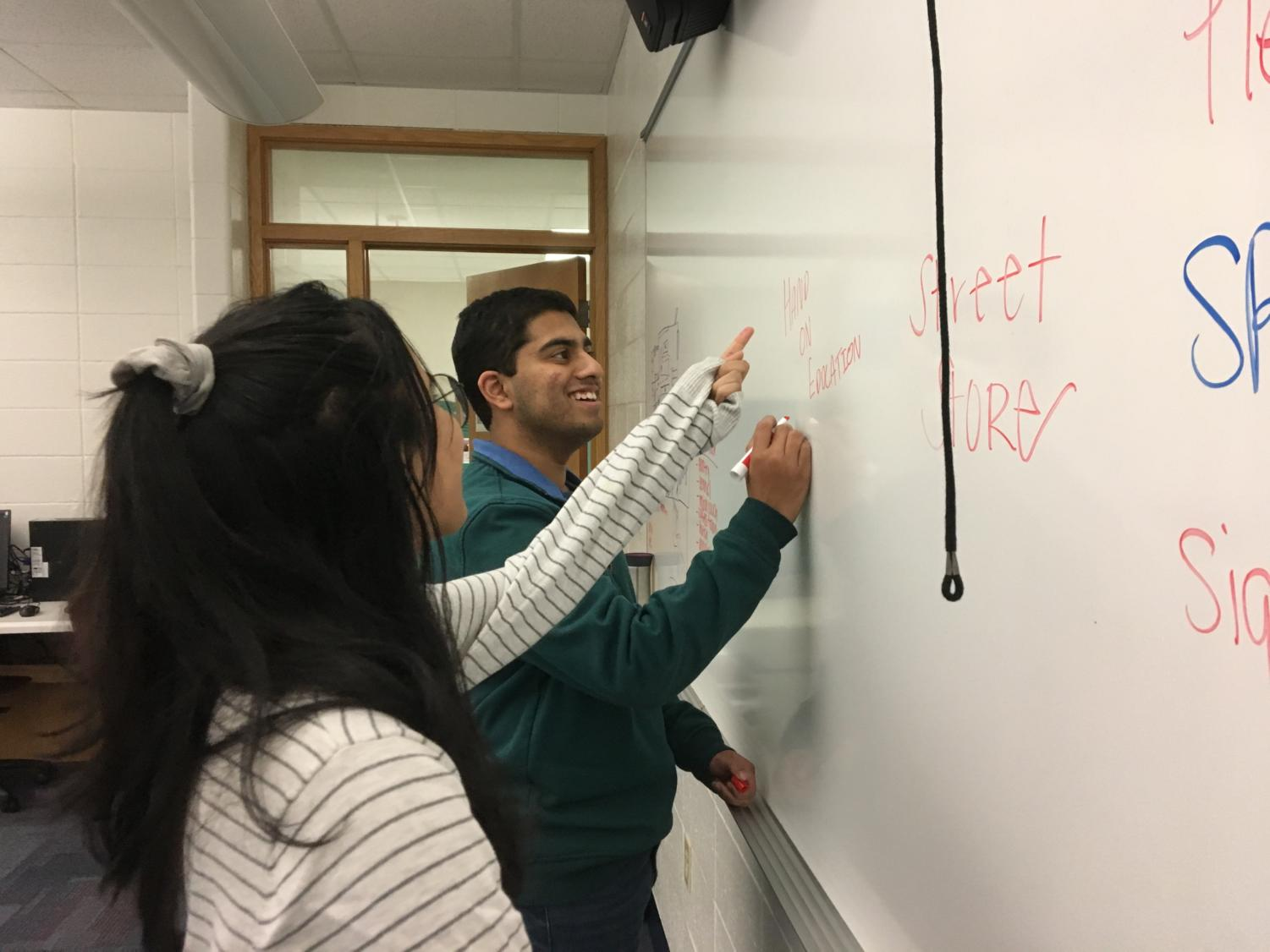 Juniors Karthik Arcot and Shivani Balachander brainstorm projects for next school year. Design for CHS has continued individual projects like Hands on Education since the Street Store event on March 16.