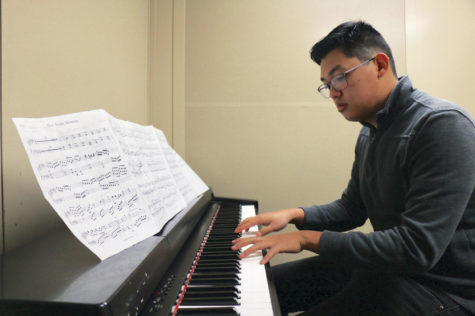 Hsu rehearses his concerto in a practice room. Hsu said he wrote his concerto for five parts.