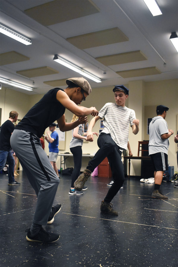 """Michael Geary (right), a freshman playing Elmer in """"Newsies,"""" practices fight choreography. He said this is his first time in a show with adults."""