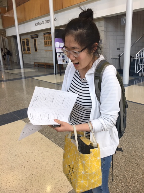Selin Oh, TEDx president and senior, studies for one of her AP exams in the hallway. Oh said she hopes many TEDx members will attend the end-of-the-year celebration on May 22 in Room E210.