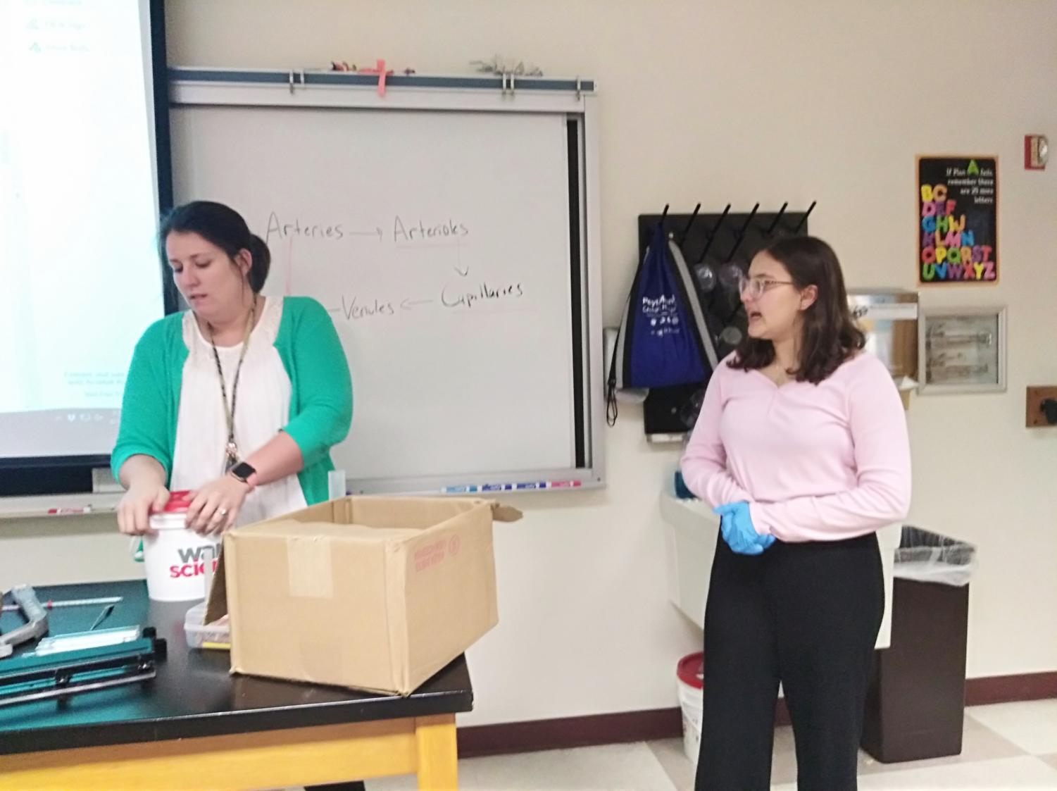 Vice President Layla Qureshi and Sponsor Alyssa Mastin talk during a Club Med meeting. Mastin said she is looking forward to what next year will bring.