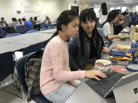 Sophomore Melissa Su and junior Hannah Liu work on their project in preparation for ICDC during lunch. ICDC took place from April 27-30.