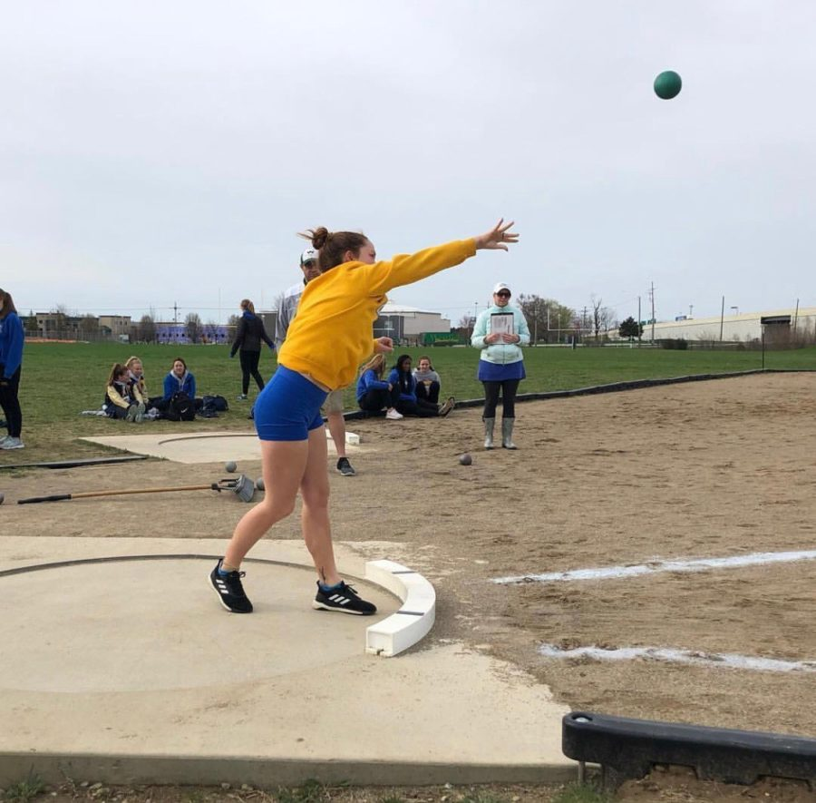 Thrower+and+senior+Mea+McCormack+competes+in+shot+put+during+a+meet+in+the+regular+season.+The+women%E2%80%99s+track+team+heads+into+the+post-season+with+Sectionals+on+May+14.