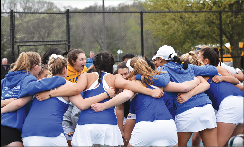 "GET HYPE: The women's tennis team huddles up before a match against Cathedral on April 23. Head coach Bryan Hanan said the team is a strong group that both alone and together push each other to improve. ""A lot of our kids are very self-motivated; we have a lot of competition here,"" Hanan said."