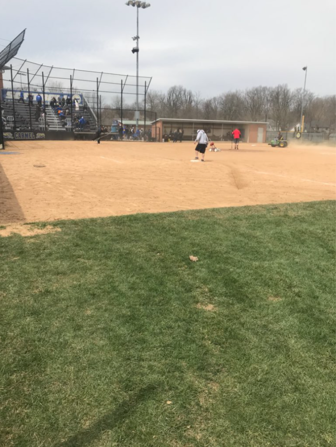 "The softball maintenance crew gets the field ready before the game versus Center Grove. ""We are hoping to play well in the postseason,"" Zdobylak said."