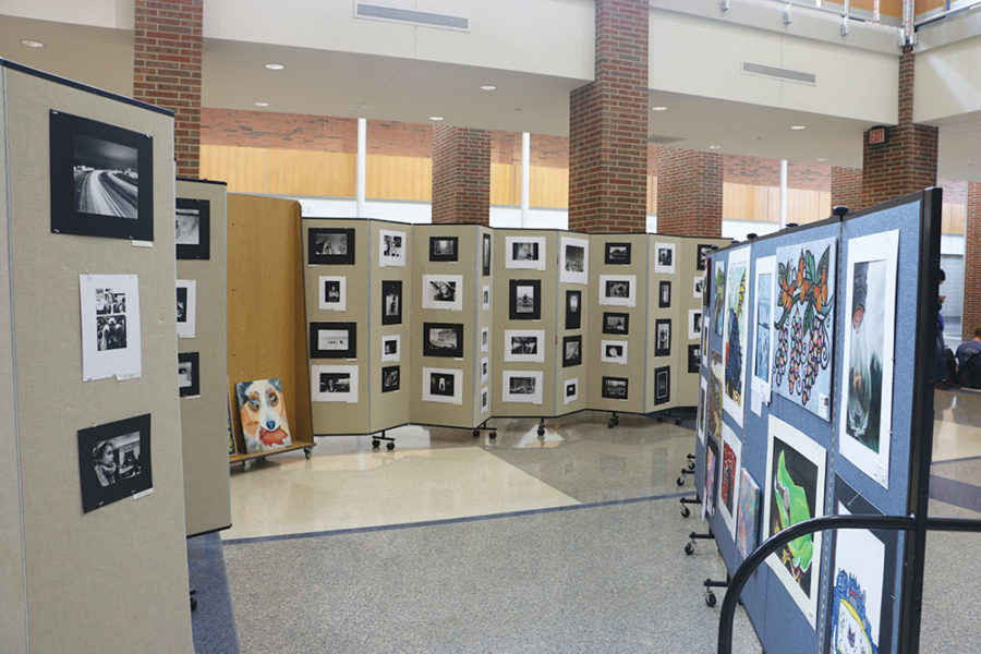 The CHS spring art gallery is set up in the commons displaying a variety pieces by students. Both senior Jessica Qu and junior Minjeong Kim said they will be choosing artwork from the gallery to display in their curated art gallery located in the CAC's Children's Gallery.