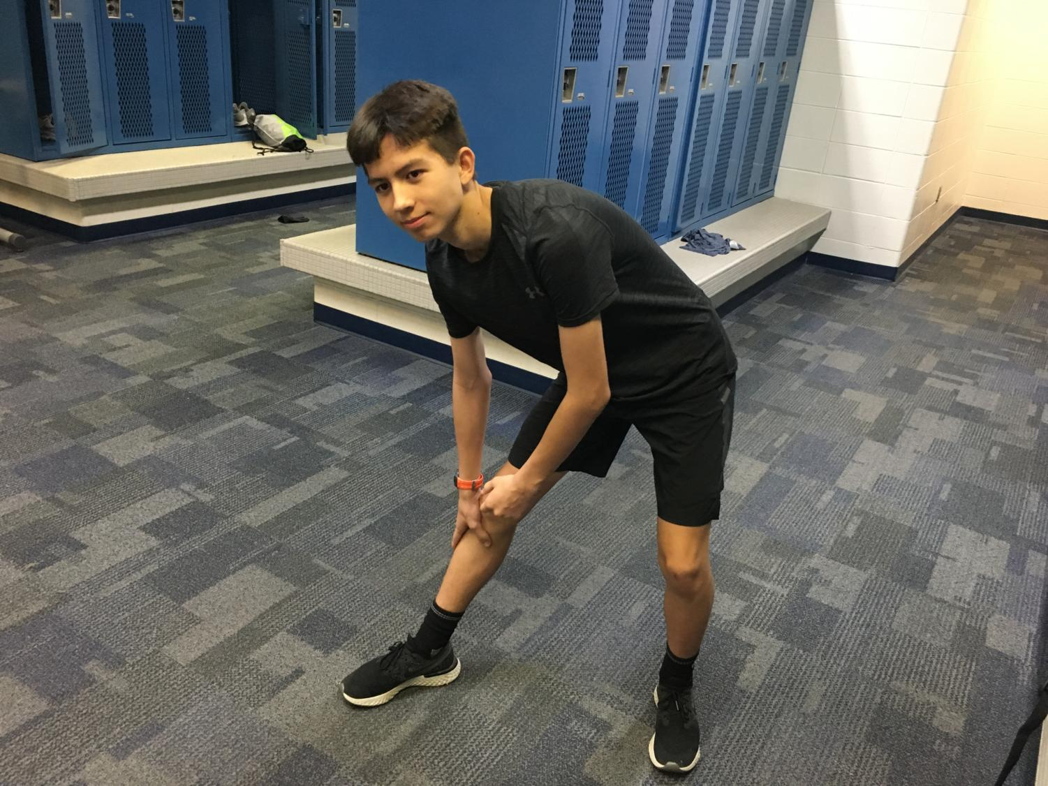 Connor Heagy, track runner and freshman, stretches after practice. The tournament roster will continue to train for Regionals on Thursday.