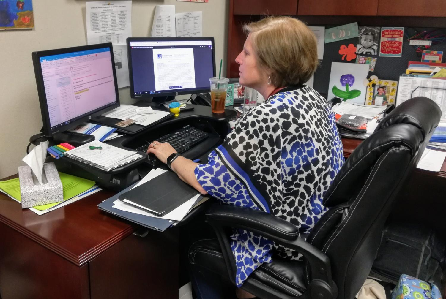 Melinda Stephan, college and careers programming and resources coordinator, reads emails and plans to send out more emails soon about AP exams. The last day of AP testing is May 17.