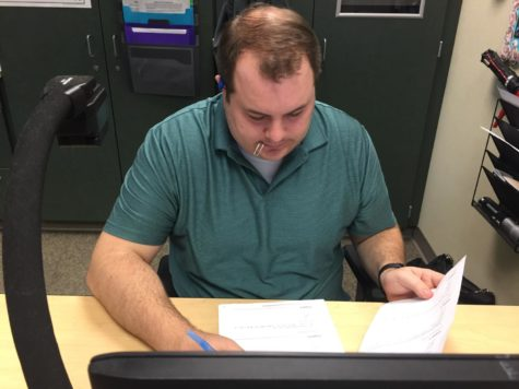 Joseph Broman, sponsor and math teacher, looks at possible competitions for the next school year. The Math Club members said although there are no more upcoming competitions for this school year, they have begun preparing for competitions next year.