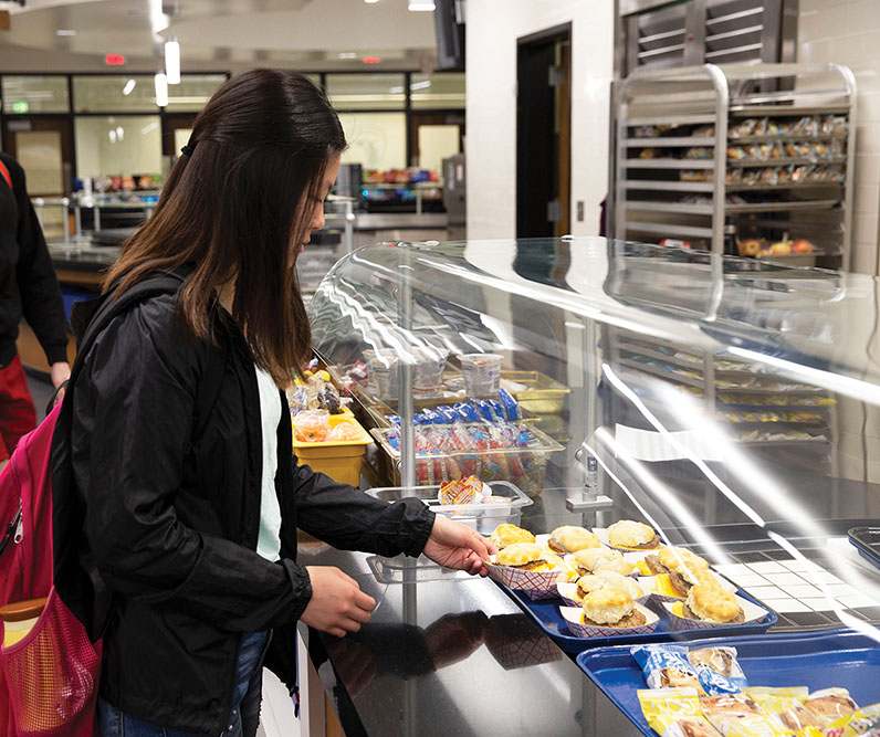 Sophomore Megan Lee purchases school breakfast in the morning. Although she said she brings her food from home when she wants to eat healthy, Lee also believes school food can be a good option sometimes.