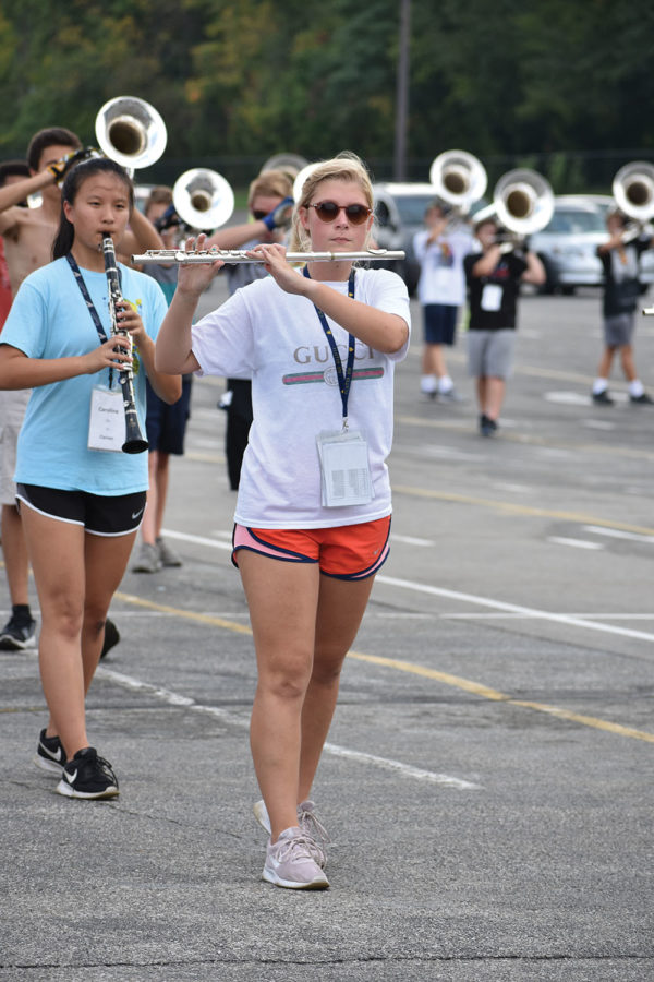 Natalie Crispin, marching band member and junior, practices during a rehearsal. Marching band will begin rehearsing at the begining of summer break to prepare for CarmelFest.