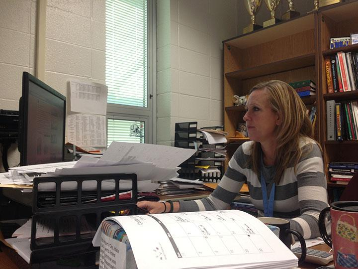 Michelle Foutz, club sponsor and Economics teacher, sits at her desk looking at emails. She said she is looking forward to next year's Economics Challenge competition.