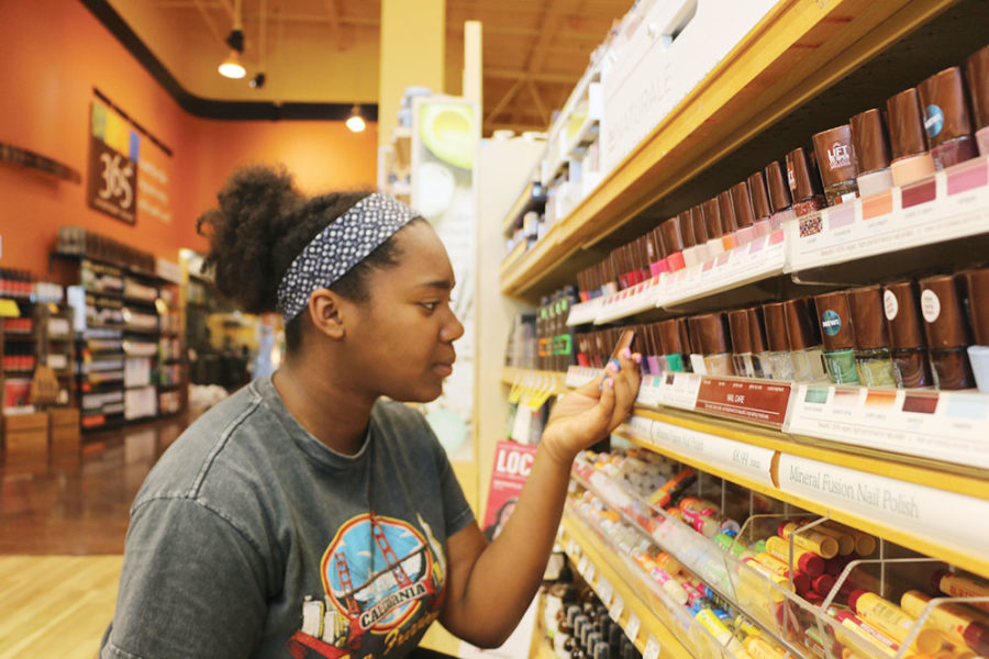 PAINTED  NAILS: Vegan and junior Carmen Broadnax explores vegan nail polish at Whole Foods. She said she does not normally use non-dietary vegan products, but she sometimes does if it is convenient for her.